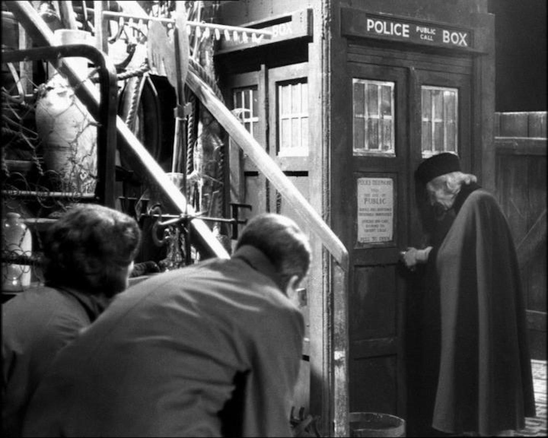 Ian Chesterton and Barbara Wright hide as the Doctor unlocks the TARDIS.