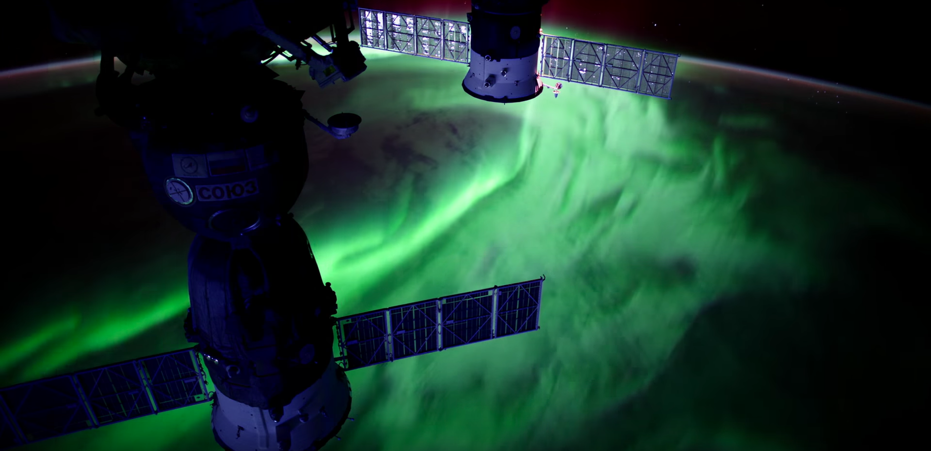 When charged particles from the sun interact with Earth's magnetic field, they produce dazzling auroras.