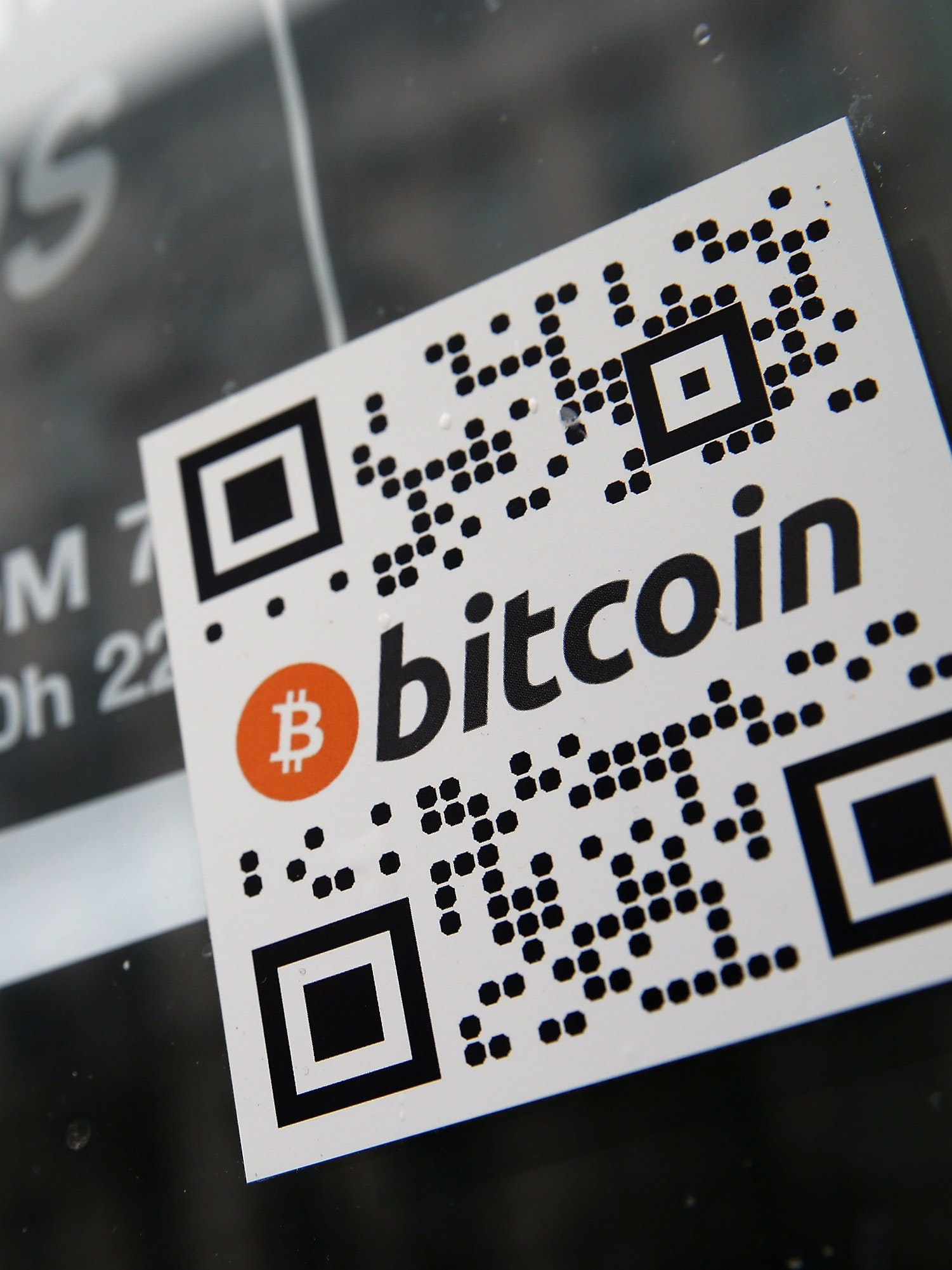 BERLIN, GERMANY - APRIL 11:  A sticker on the window of a local pub indicates the acceptance of Bitcoins for payment on April 11, 2013 in Berlin, Germany. Bitcoins are a digital currency traded on the MTGox exchange, and the value of the virtual money fluctuated from USD 260 per bitcoin down to USD 130 per bitcoin yesterday and recovered somewhat in trading today.  (Photo by Sean Gallup/Getty Images)