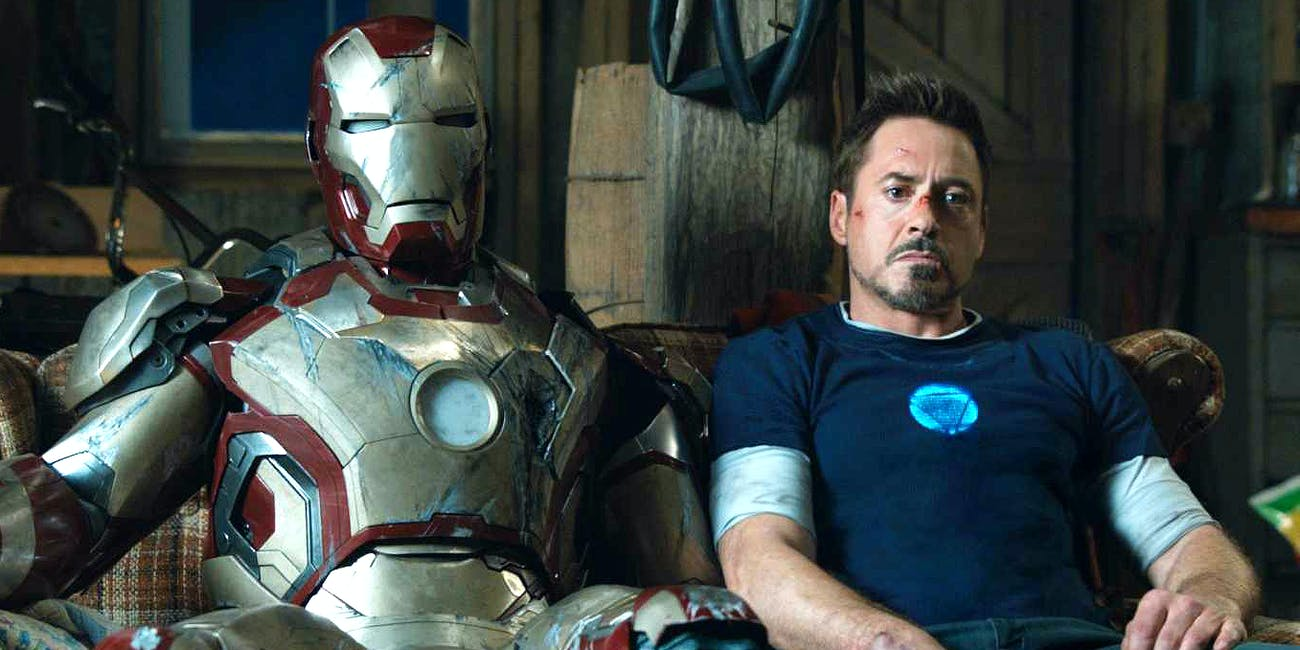 Tony Stark sitting next to his armor in 'Iron Man 3'.