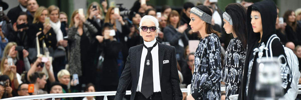 Chanel designer Karl Lagerfeld appears on the runway at the grand finale of the Chanel fashion show at Paris Fashion Week on Tuesday.