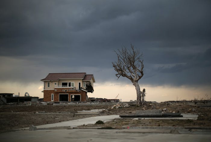 A lone house sits on the scarred landscape, inside the exclusion zone, close to the devastated Fukushima Daiichi Nuclear Power Plant on February 26, 2016 in Namie, Fukushima Japan. The area is now closed to residents due radiation contamination from the Fukishima nuclear disaster.