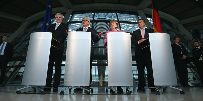 (From L to R) Bavarian Christian Democrats (CSU) Chairman Horst Seehofer, Foreign Minister Frank-Walter Steinmeier, Chancellor and German Christian Democrats (CDU) Chairwoman Angela Merkel and German Social Democrats Chairman Sigmar Gabriel speak to the media after Steinmeier was confirmed to become Germany's next president at the Bundestag on November 16, 2016 in Berlin, Germany. Steinmeier will succeed current President Joachim Gauck will be elected by the Federal Assembly in February.