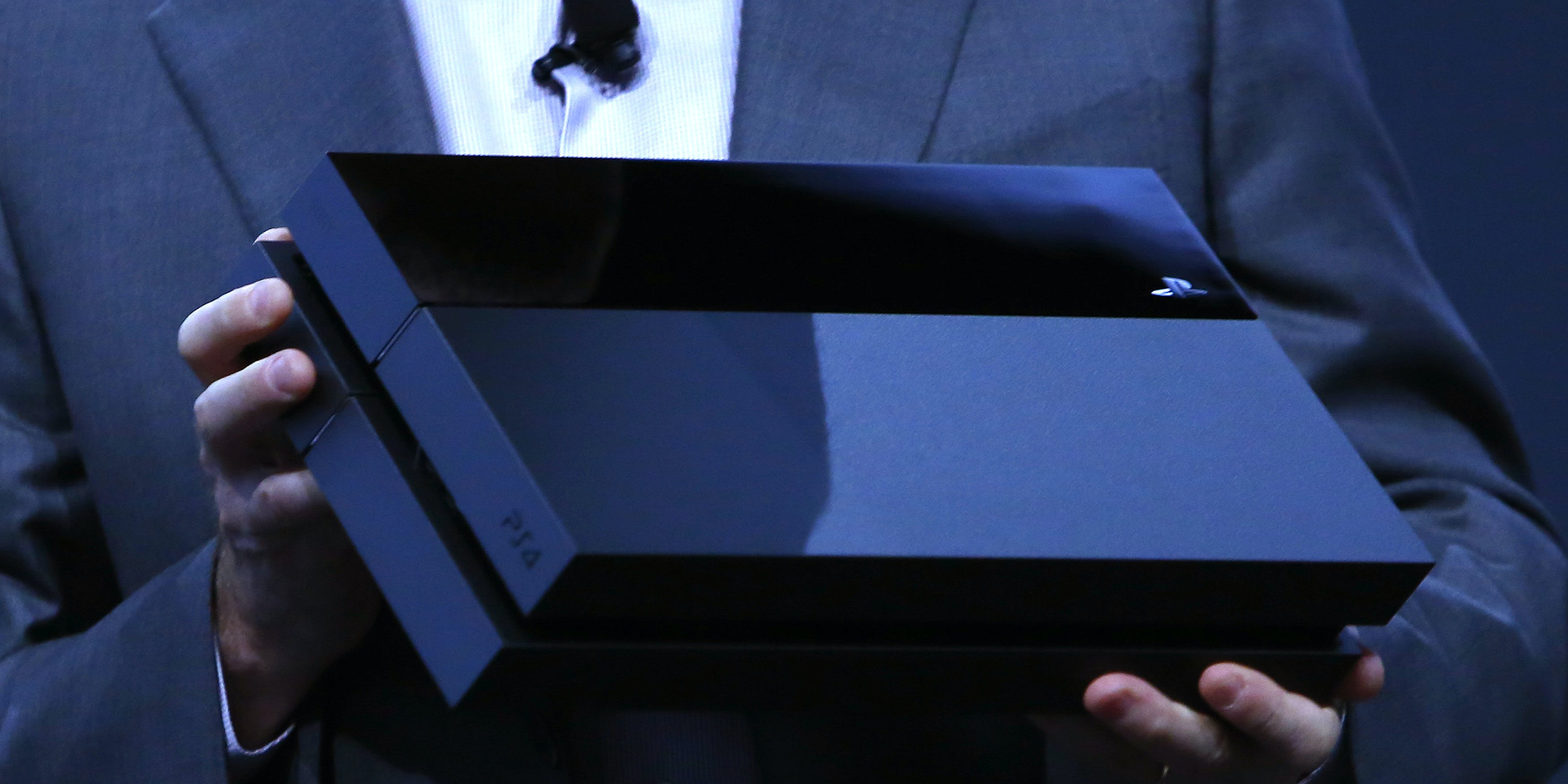 LOS ANGELES, CA - JUNE 10:  Andrew House, President and Group CEO Sony Computer Entertainment Inc., holds up a Playstation 4 at the Sony Playstation E3 2013 press conference June 10, 2013 in Los Angeles, California. Thousands are expected to attend the annual three-day convention to see the latest games and announcements from the gaming industry.(Photo by Eric Thayer/Getty Images)