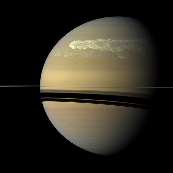 A huge storm churning across the face of Saturn.  At the time this image was taken, 12 weeks after the storm began, it had  completely wrapped around the planet.