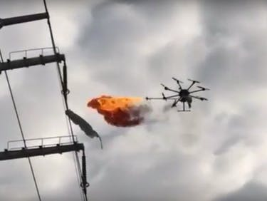 Drone burning trash off power lines in Xiangyang.