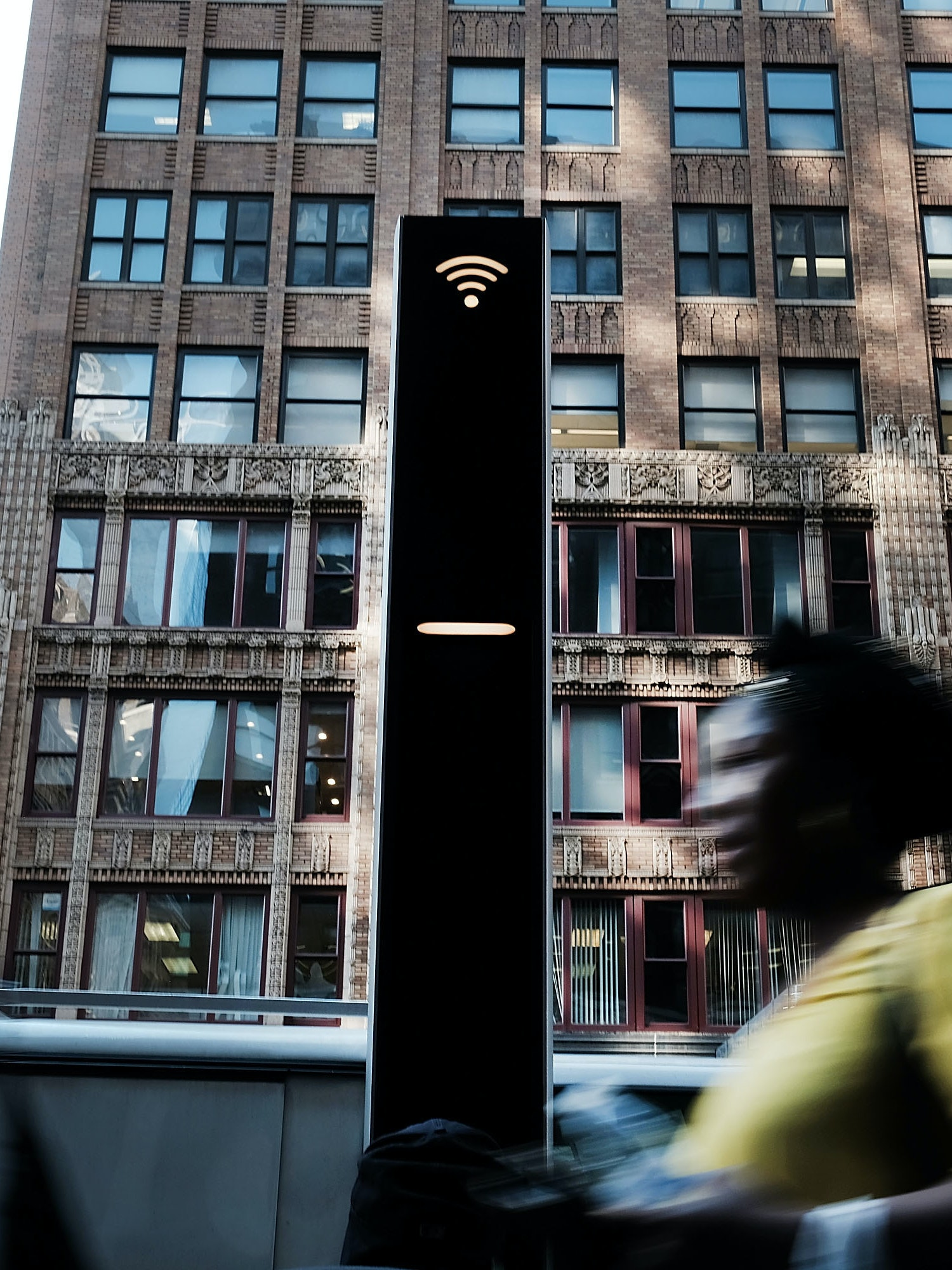 NEW YORK, NY - AUGUST 24:  Pedestrians pass one of the new Wi-Fi kiosks that offer free web surfing, phone calls and a charging station on August 24, 2016 in New York City. The LinkNYC terminals, which number around 300 in Manhattan, have become especially popular with both the homeless and panhandlers. The free kiosks are being installed to replace obsolete pay phones around Manhattan.  (Photo by Spencer Platt/Getty Images)