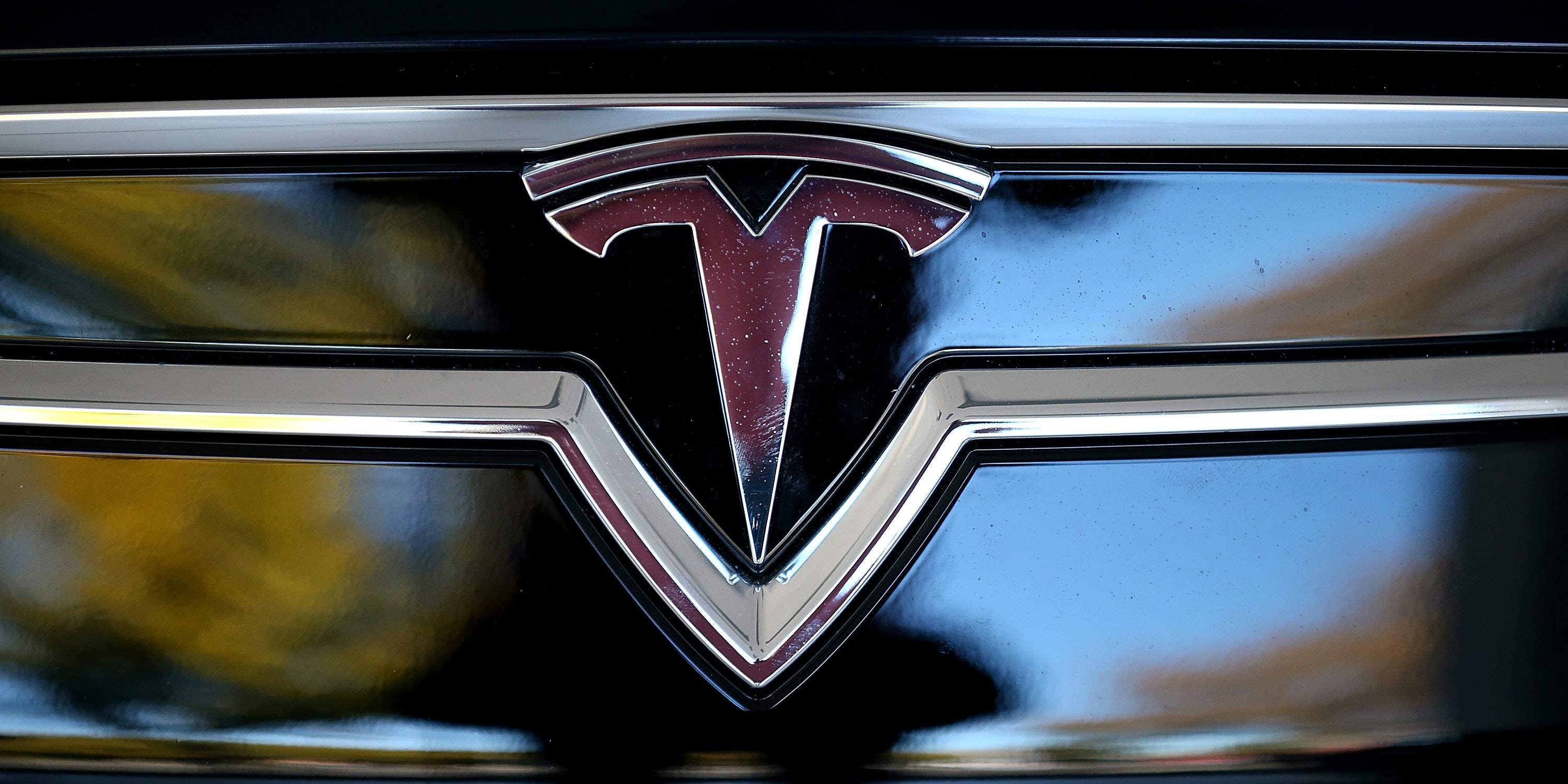 PALO ALTO, CA - NOVEMBER 05:  The Tesla logo is shown on the front of a new Tesla Model S car at a Tesla showroom on November 5, 2013 in Palo Alto, California. Tesla will report third quarter earnings today after the closing bell.  (Photo by Justin Sullivan/Getty Images)