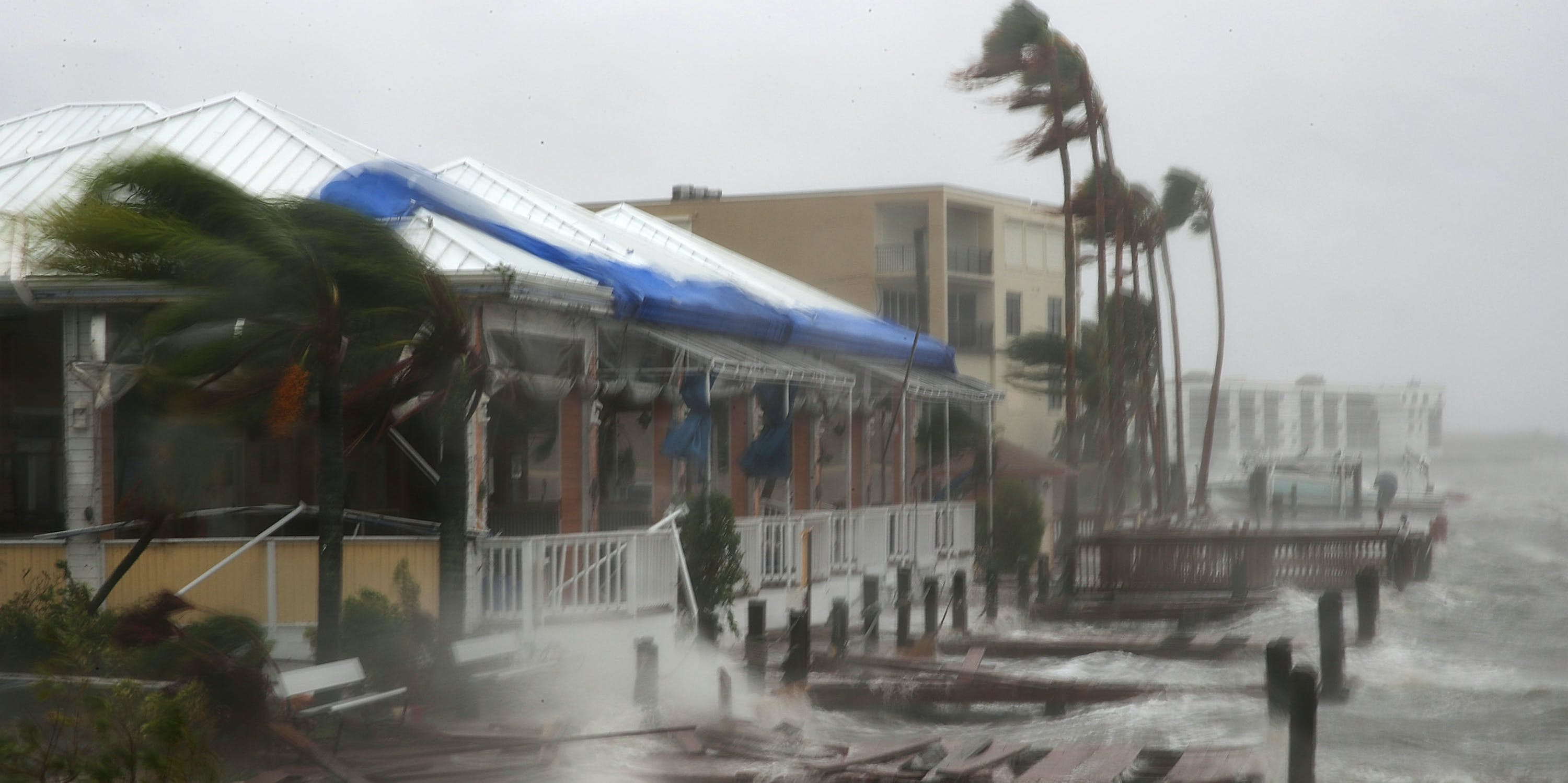 Heavy waves caused by Hurricane Matthew pound the boat docks at the Sunset Bar and Grill, October 7, 2016 on Cocoa Beach, Florida.