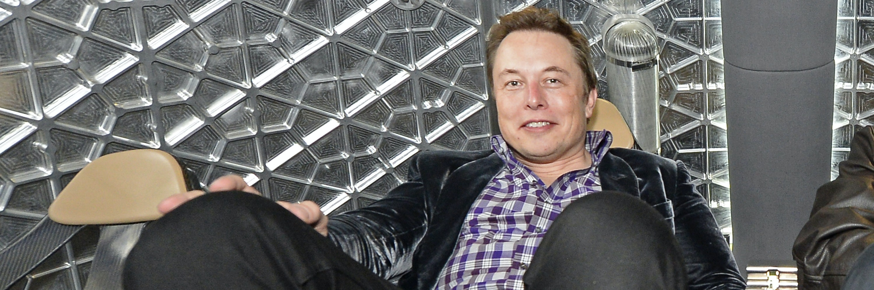 HAWTHORNE-CA-MAY 29:  SpaceX CEO Elon Musk sits inside the manned capsule Dragon V2 after unveiling it at the company's headquarters on May 29, 2014, in Hawthorne, California. The private spaceflight company has been flying unmanned capsules to the Space Station delivering cargo for the past two years. The Dragon V2 manned spacecraft will ferry up to seven astronauts to low-Earth orbit. (Photo by Kevork Djansezian/Getty Images)