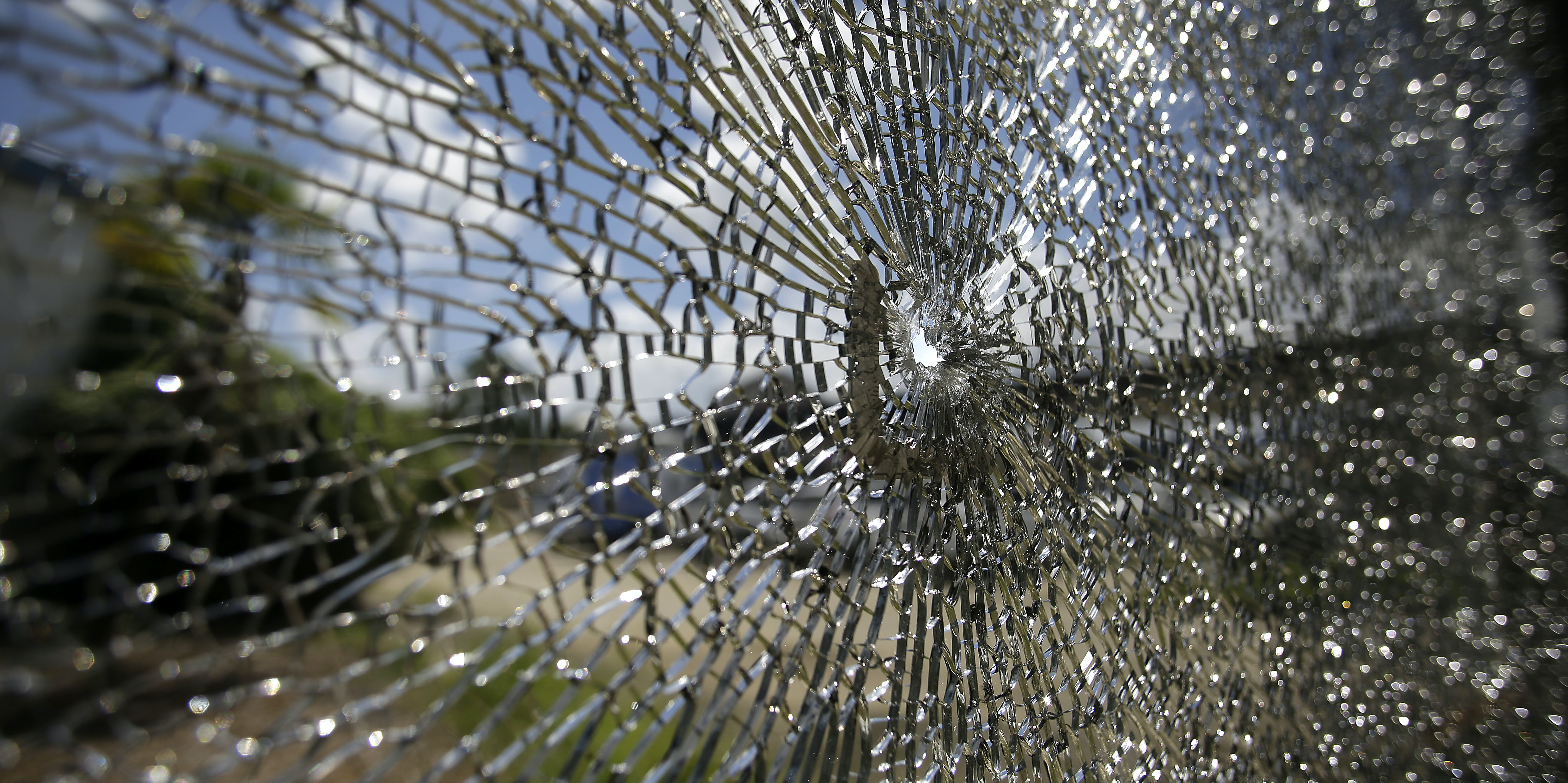 A bullet hole is seen in the window of the Fitness Expo on July 19, 2016 in Baton Rouge, Louisiana.