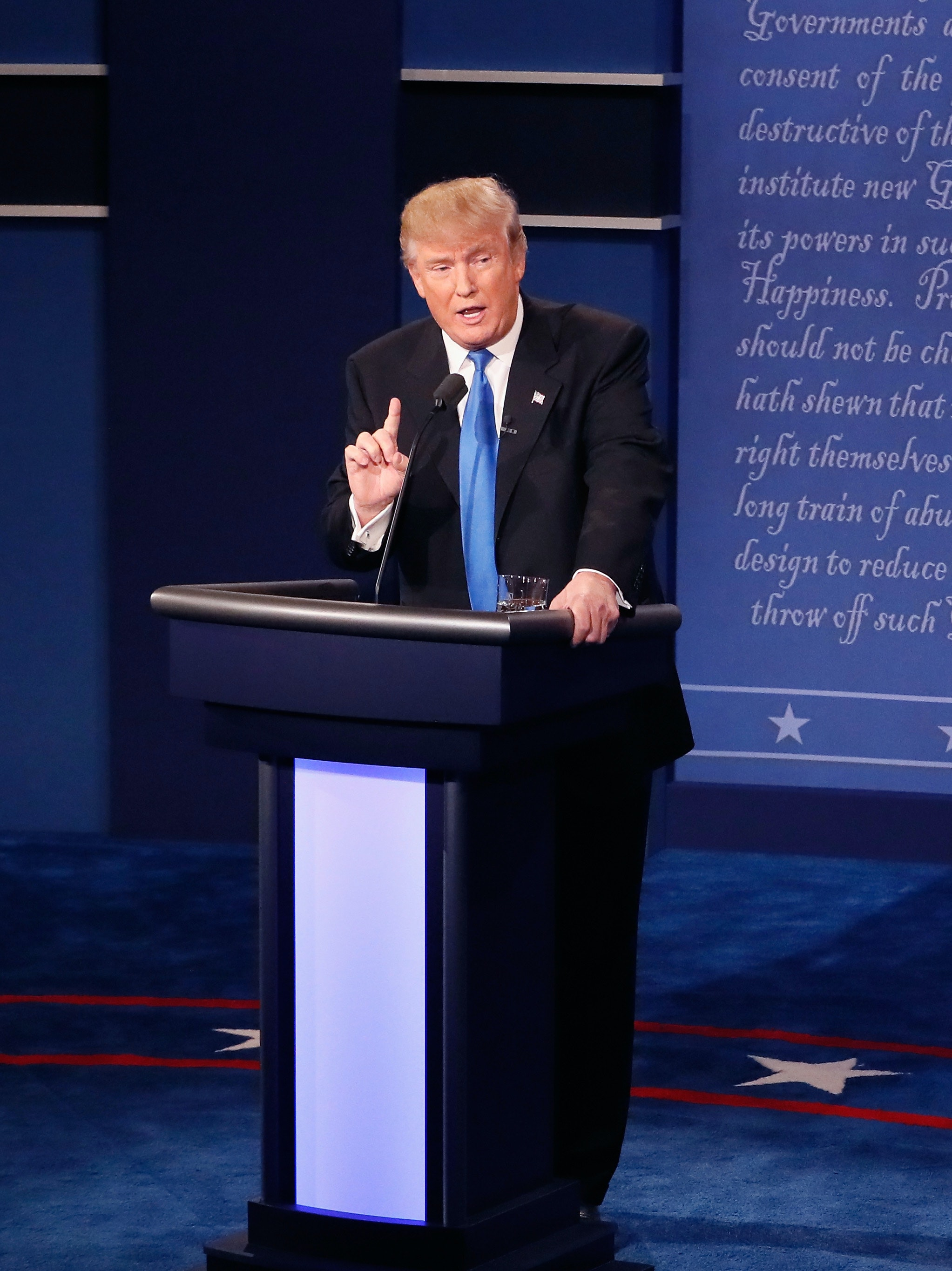 Republican presidential nominee Donald Trump (L) speaks as Democratic presidential nominee Hillary Clinton listens during the Presidential Debate at Hofstra University on September 26, 2016 in Hempstead, New York. The first of four debates for the 2016 Election, three Presidential and one Vice Presidential, is moderated by NBC's Lester Holt.