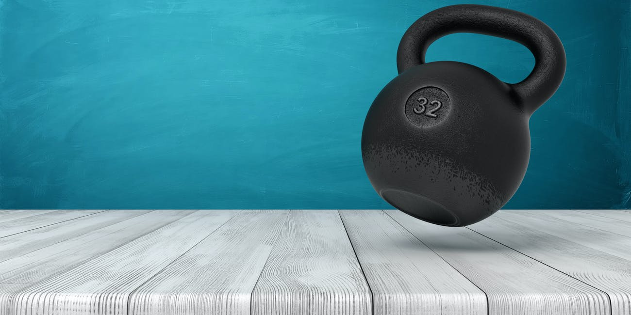 3d rendering of a 32 kg kettlebell on white wooden floor and dark turquoise background
