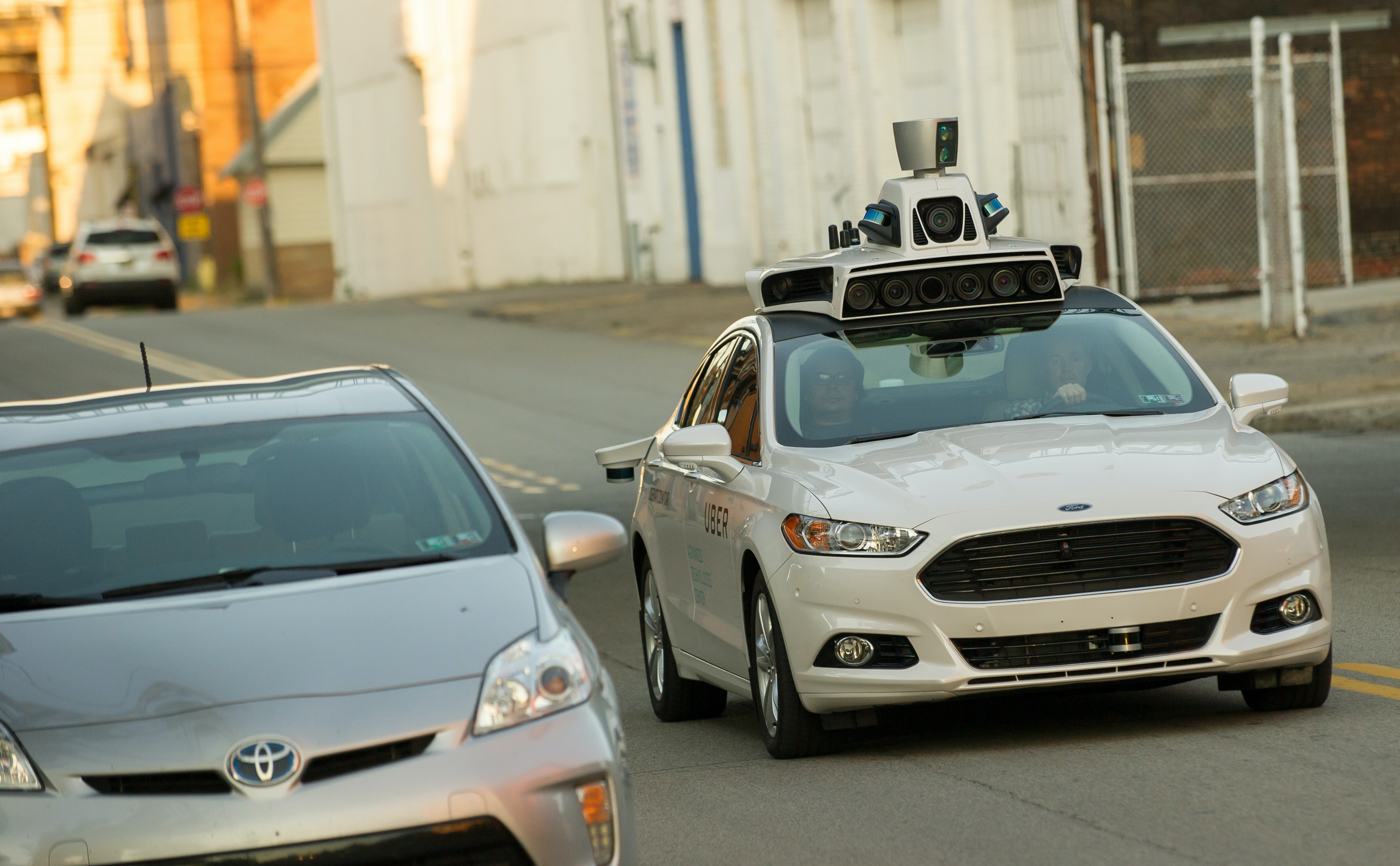 An Uber driverless Ford Fusion drives down Smallman Street on September, 22, 2016 in Pittsburgh, Pennsylvania.