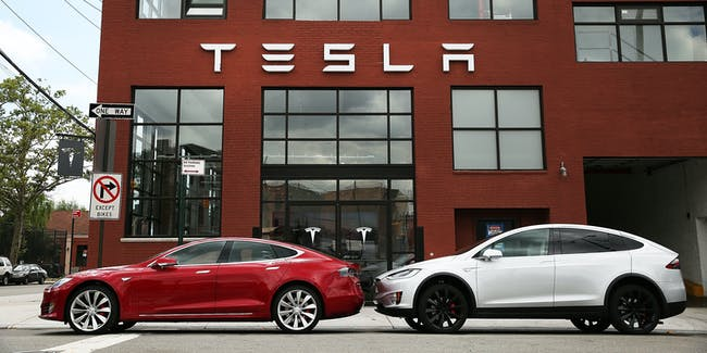 Tesla vehicles sit parked outside of a new Tesla showroom and service center in Red Hook, Brooklyn on July 5, 2016 in New York City. The electric car company and its CEO and founder Elon Musk have come under increasing scrutiny following a crash of one of its electric cars while using the controversial autopilot service. Joshua Brown crashed and died in Florida on May 7 in a Tesla car that was operating on autopilot, which means that Brown's hands were not on the steering wheel.
