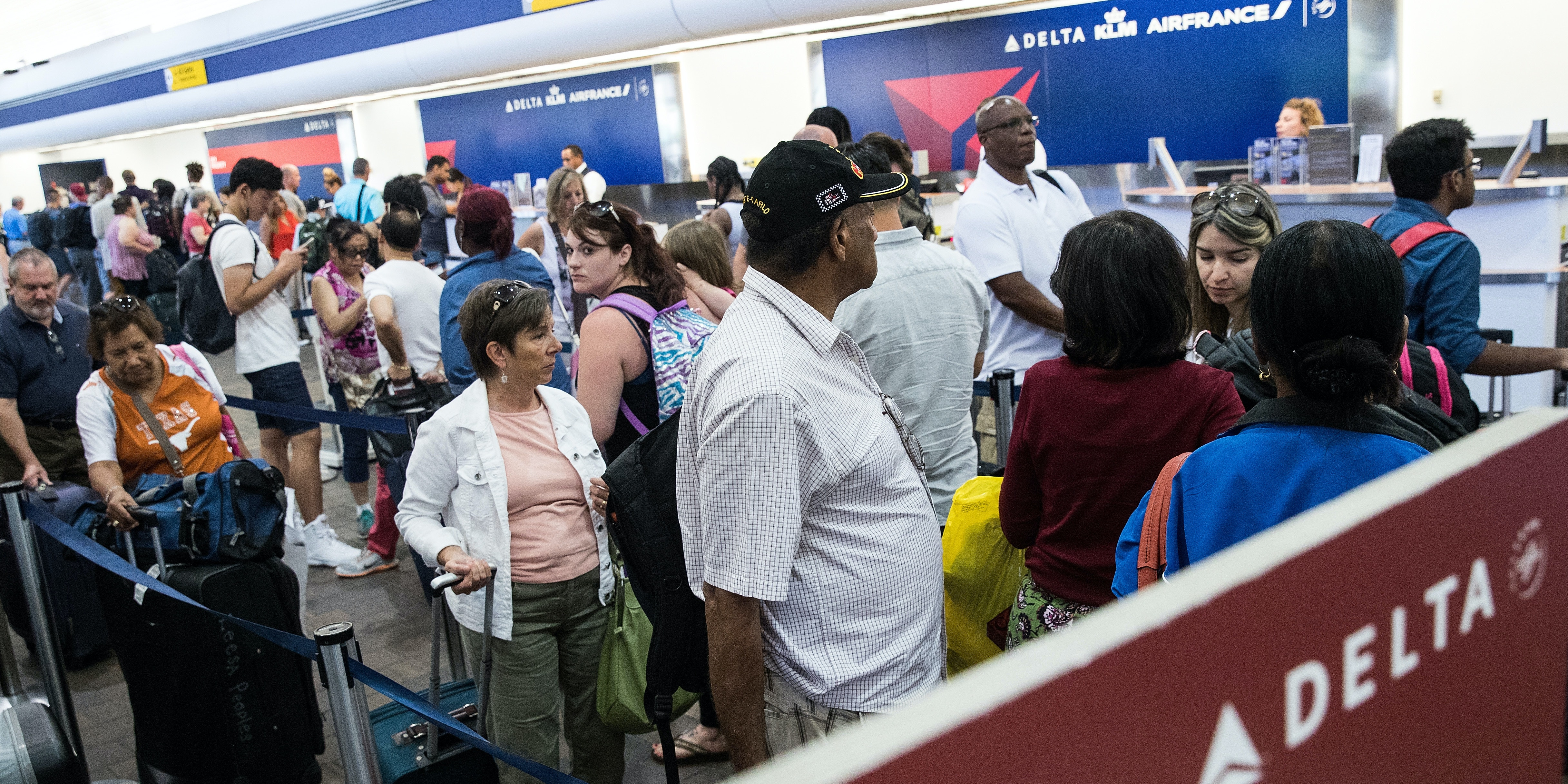 NEW YORK, NY - AUGUST 8: Travelers wait in line at the Delta check-in counter at LaGuardia Airport , August 8, 2016 in the Queens borough of New York City. Delta flights around the globe were grounded and delayed on Monday morning due to a system outage. (Photo by Drew Angerer/Getty Images)