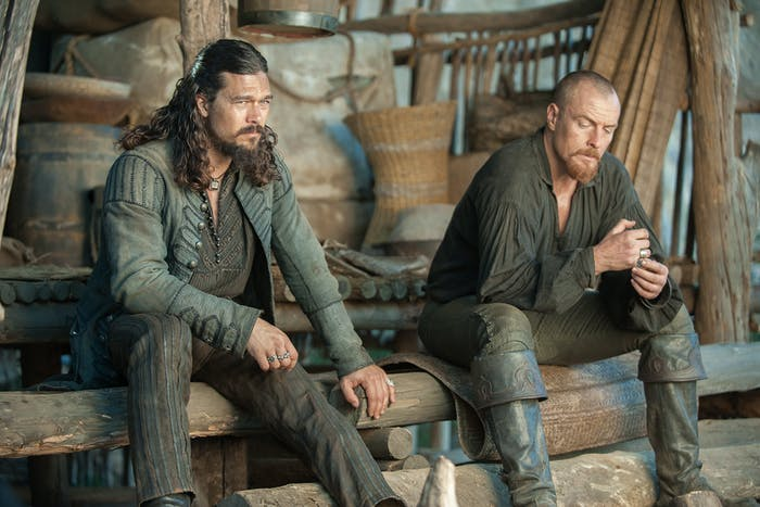 Luke Arnold as Silver and Toby Stephens as Flint