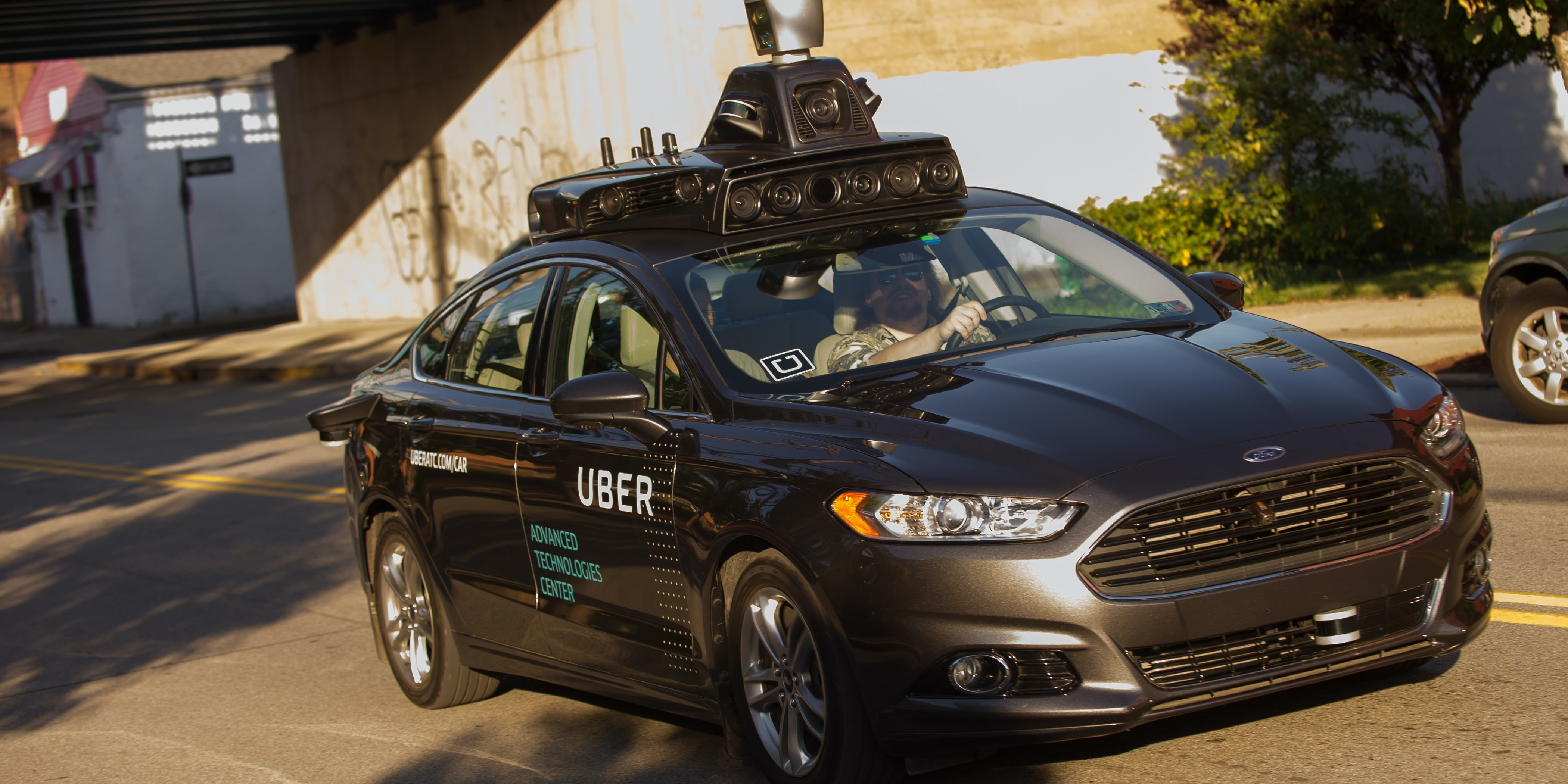 An Uber driverless Ford Fusion drives down Smallman Street on September, 22, 2016 in Pittsburgh, Pennsylvania. Uber has built its Uber Technical Center in Pittsburgh and is developing an autonomous vehicle that it hopes will be able to transport its millions of clients without the need for a driver.