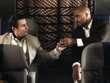 Ian McShane as Wedesday and Ricky Whittle as Shadow in 'American Gods'