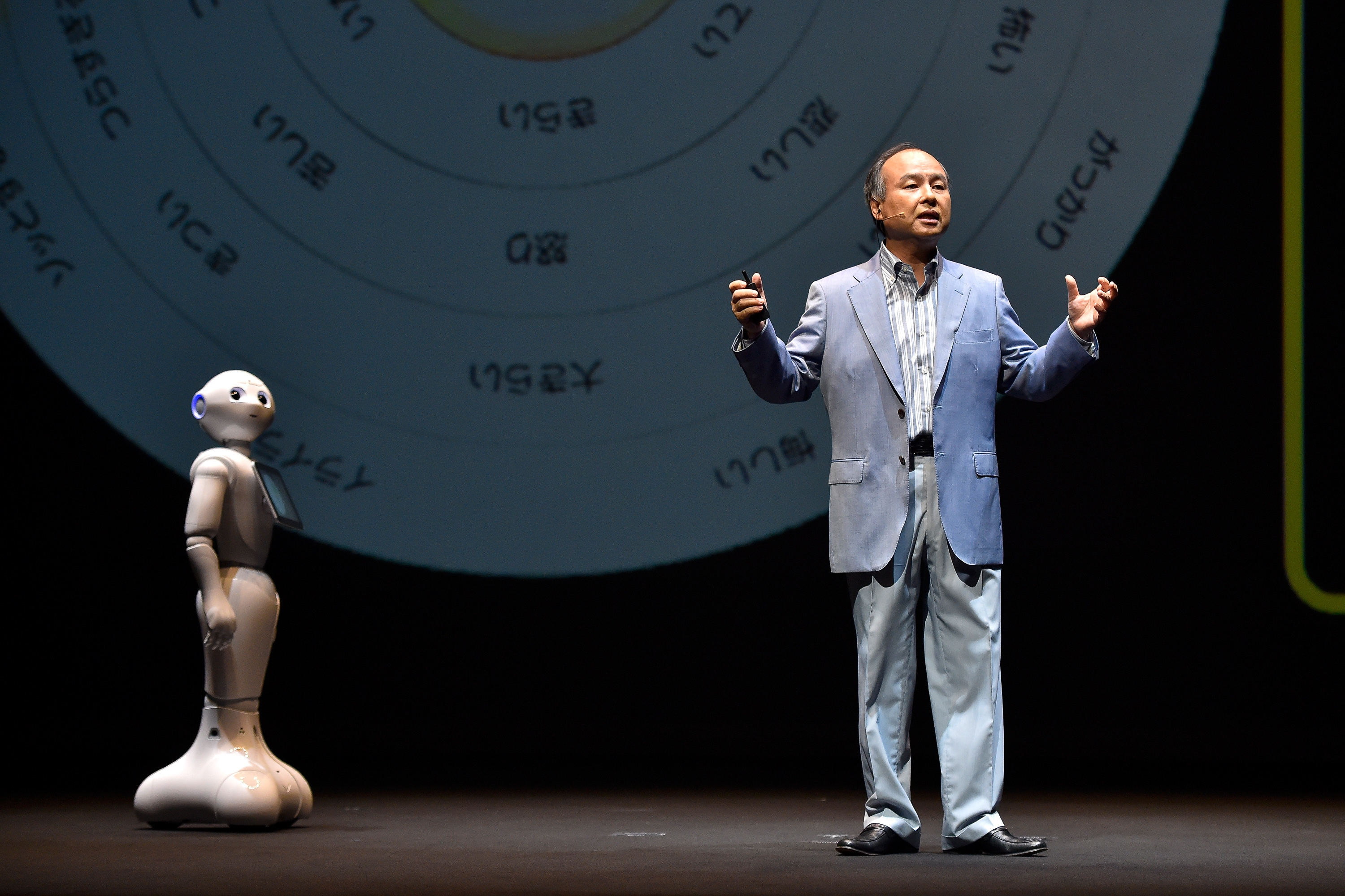 Pepper and Masayoshi Son, Chairman and Chief executive officer of SoftBank Corp talk during the news conference on June 18, 2015 in Chiba, Japan.