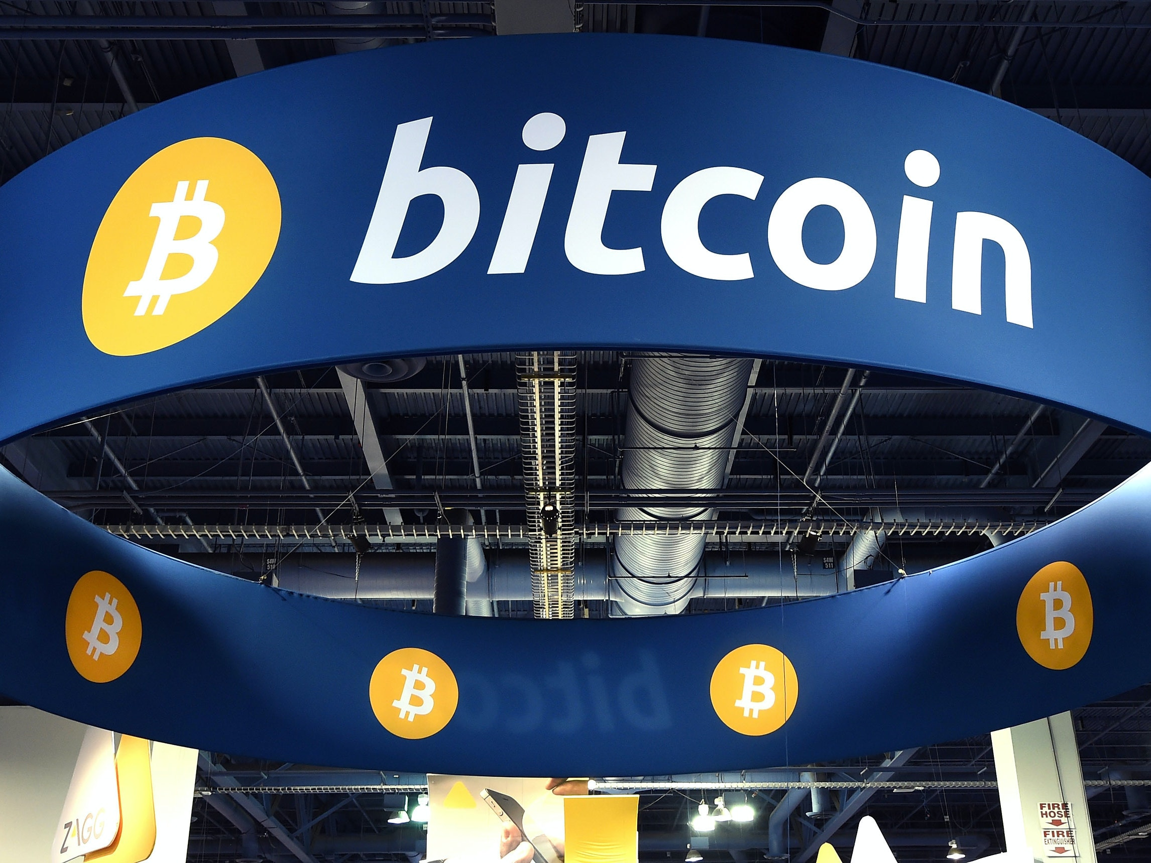 LAS VEGAS, NV - JANUARY 08:  A general view of the Bitcoin booth at the 2015 International CES at the Las Vegas Convention Center on January 8, 2015 in Las Vegas, Nevada. CES, the world's largest annual consumer technology trade show, runs through January 9 and is expected to feature 3,600 exhibitors showing off their latest products and services to about 150,000 attendees.  (Photo by Ethan Miller/Getty Images)