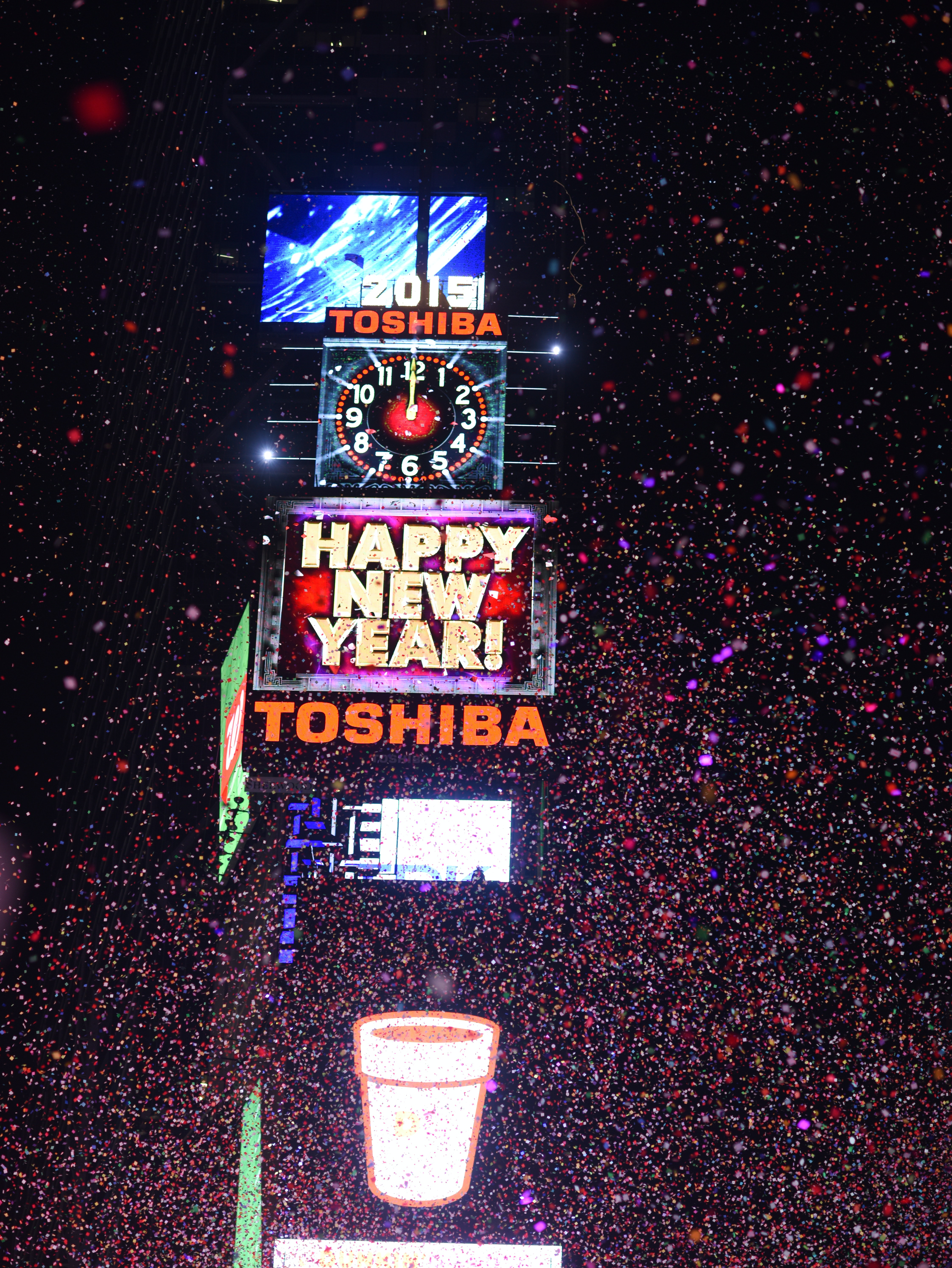 NEW YORK, NY - JANUARY 1:  People cheer as the ball drops at midnight in Times Square on January 1, 2015 in New York City. An estimated one million people from around the world are expected to pack Times Square to ring in 2015. (Photo by Andrew Theodorakis/Getty Images)
