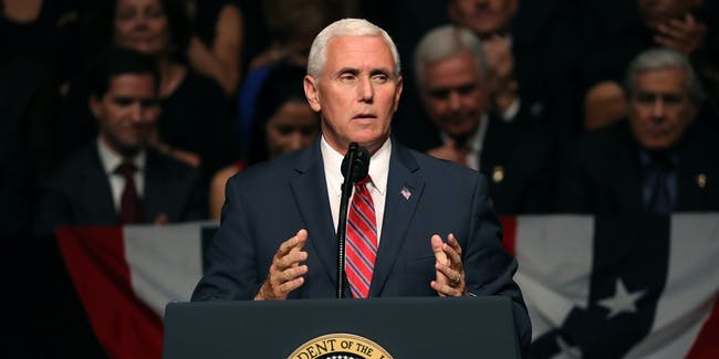 MIAMI, FL - JUNE 16: U.S. Vice President Mike Pence speaks ahead of U.S. President Donald Trump announcing policy changes he is making toward Cuba at the Manuel Artime Theater in the Little Havana neighborhood on June 16, 2017 in Miami, Florida. The President will re-institute some of the restrictions on travel to Cuba and U.S. business dealings with entities tied to the Cuban military and intelligence services. (Photo by Joe Raedle/Getty Images)