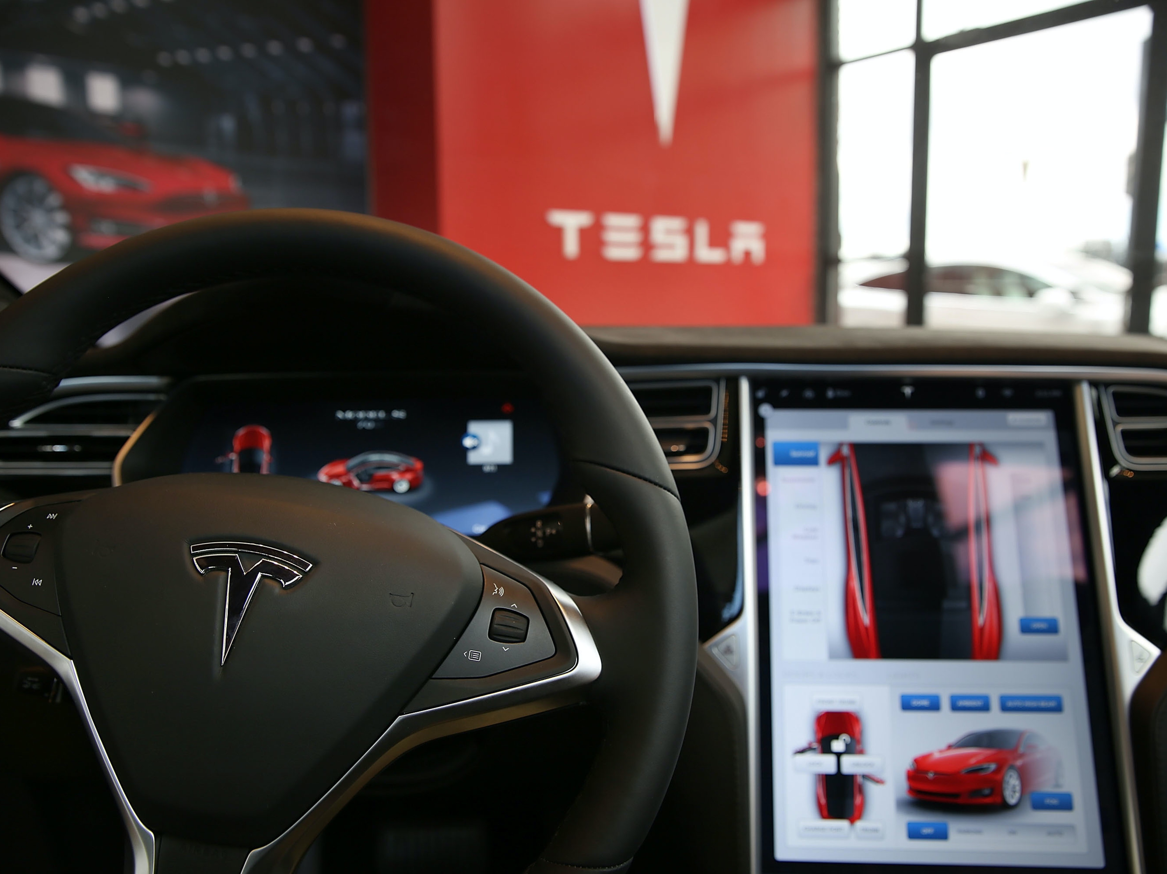 The inside of a Tesla vehicle is viewed as it sits parked in a new Tesla showroom and service center in Red Hook, Brooklyn on July 5, 2016 in New York City.