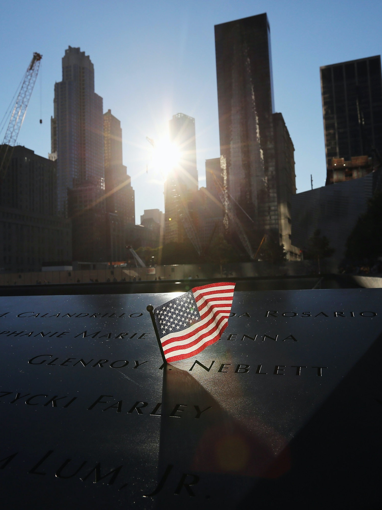 A flag sits in a name of the 9/11 Memorial before ceremonies for the eleventh anniversary of the terrorist attacks on lower Manhattan at the World Trade Center on September 11, 2012 in New York City.