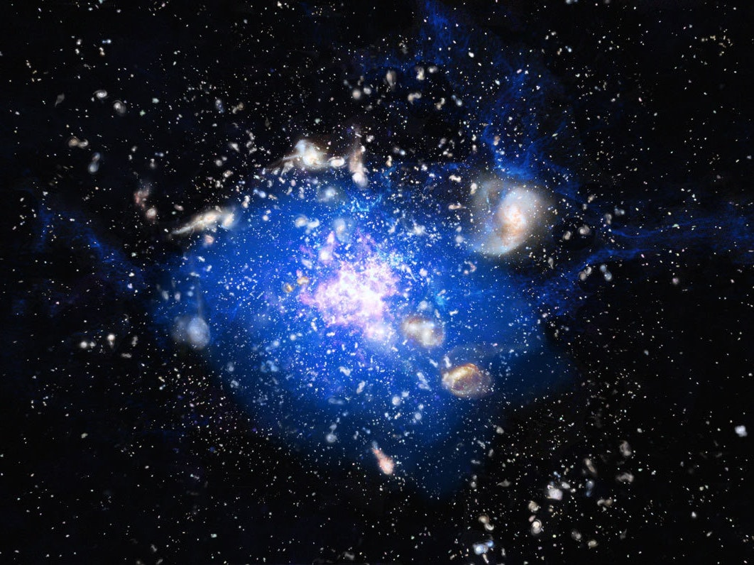 Artist conception of the spiderweb. Protogalaxies are shown in white and pink, with carbon monoxide gas shown in blue.