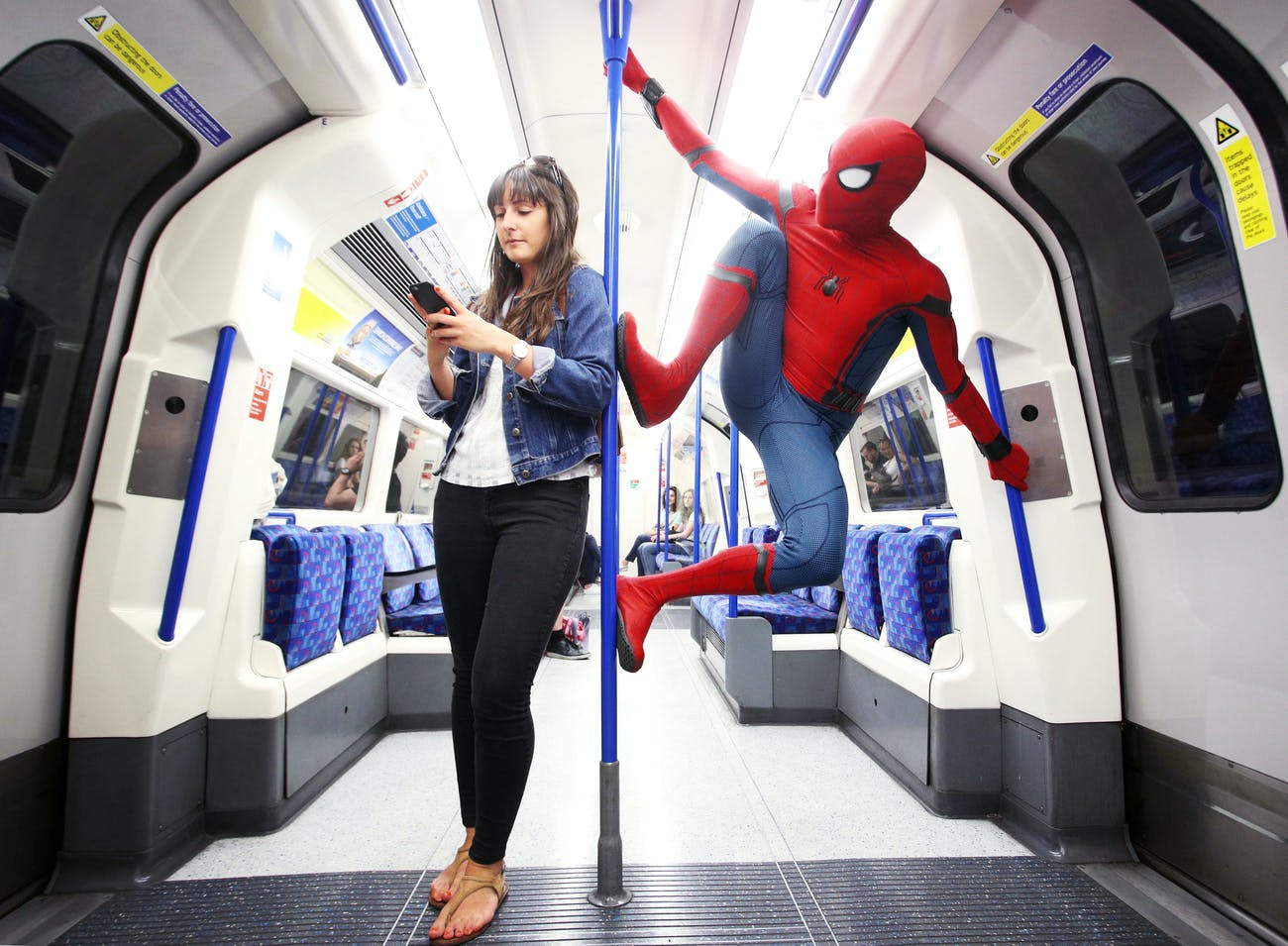 Spidey rides the tube, perhaps because there aren't enough tall buildings in London?