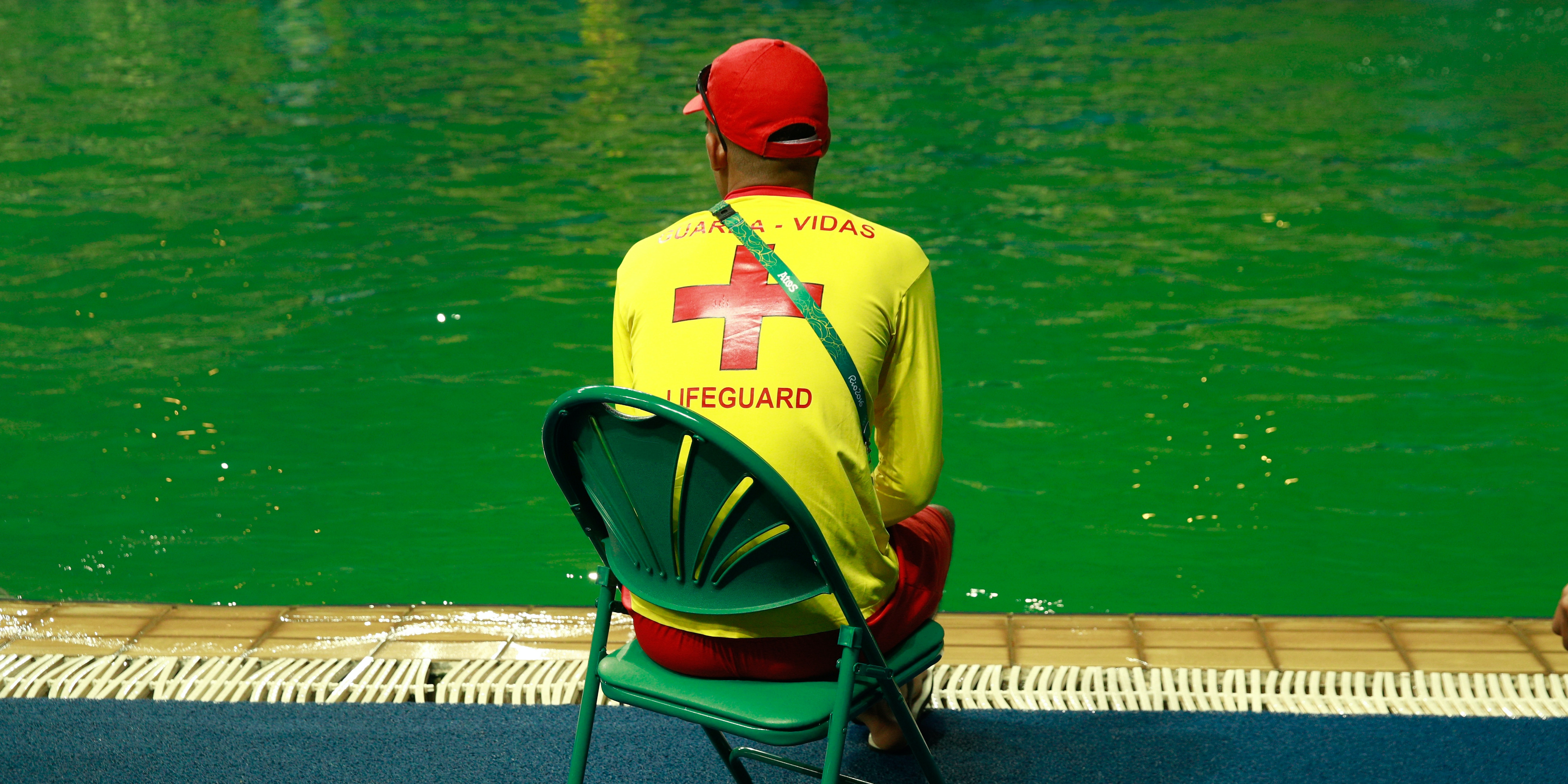 A lifeguard sits by the edge of the diving pool at Maria Lenk Aquatics Centre on Day 4 of the Rio 2016 Olympic Games at Maria Lenk Aquatics Centre on August 9, 2016 in Rio de Janeiro, Brazil.
