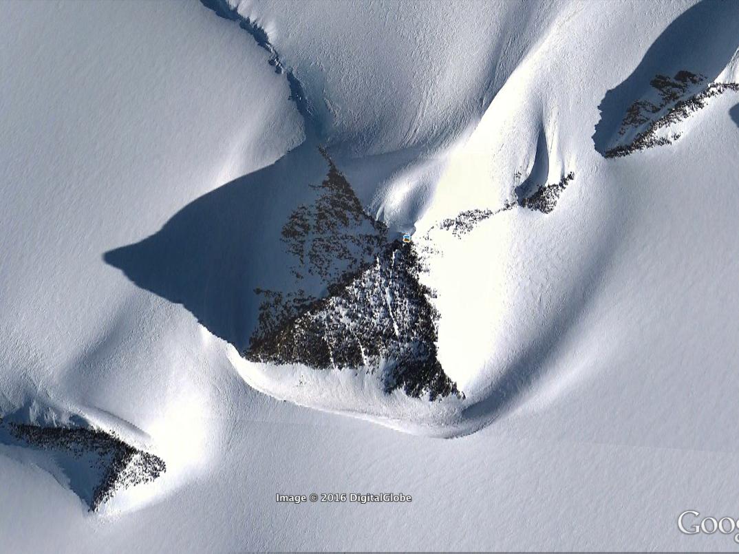Antarctica pyramid mountain UFO alien