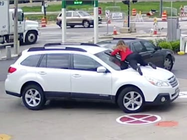 Watch a Woman Literally Hurtle Onto Her SUV to Stop a Carjacker