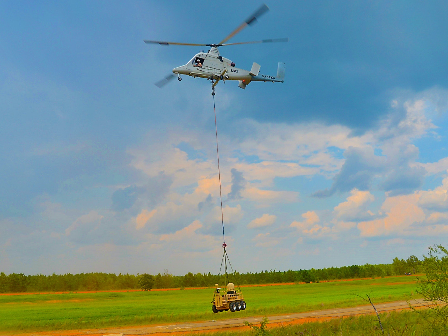"""A """"Dismounted Soldier Autonomy Tools,"""" or DSAT, being lowered by a helicopter."""