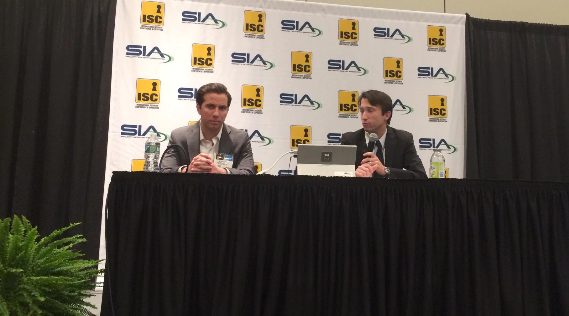 Joseph Hoellerer, left, and Jake Parker of the Security Industry Association speak at ISC East.