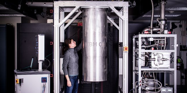 IBM Research Staff Member Katie Pooley, a Physics PhD from Harvard who recently joined IBM, at the Thomas J Watson Research Center, is a process integrator on the IBM Q team. In the photo, Pooley is examining a cryostat with the new prototype of a commercial quantum processor inside.