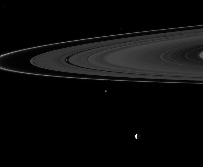 This image captured by Cassini shows six of Saturn's moons: Enceladus, Janus, Epimetheus, Atlas, Daphnis, and Pan.
