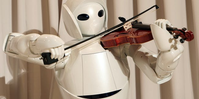 TOKYO - DECEMBER 06:  Toyota's violin-playing robot plays at Universal Design Showcase on December 6,2007 in Tokyo, Japan. The robot, which has 17 joints in both arms, uses precise control to play the violin. Toyota aims to develop robot technology to assist nursing and medical care by the year 2010.  (Photo by Koichi Kamoshida/Getty Images)
