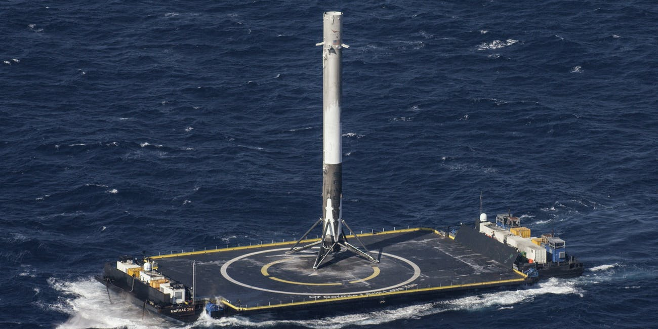 CAPE CANAVERAL, FL - APRIL 8: In this handout provided by the National Aeronautics and Space Administration (NASA), SpaceX's Falcon 9 rocket stands after making its first successful upright landing on the 'Of Course I Still Love You' droneship on April 8, 2016 some 200 miles off shore in the Atlantic Ocean after launching from Cape Canaveral, Florida. (Photo by NASA via Getty Images)