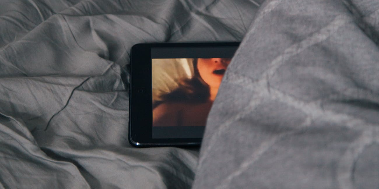 porn on a tablet in a bed