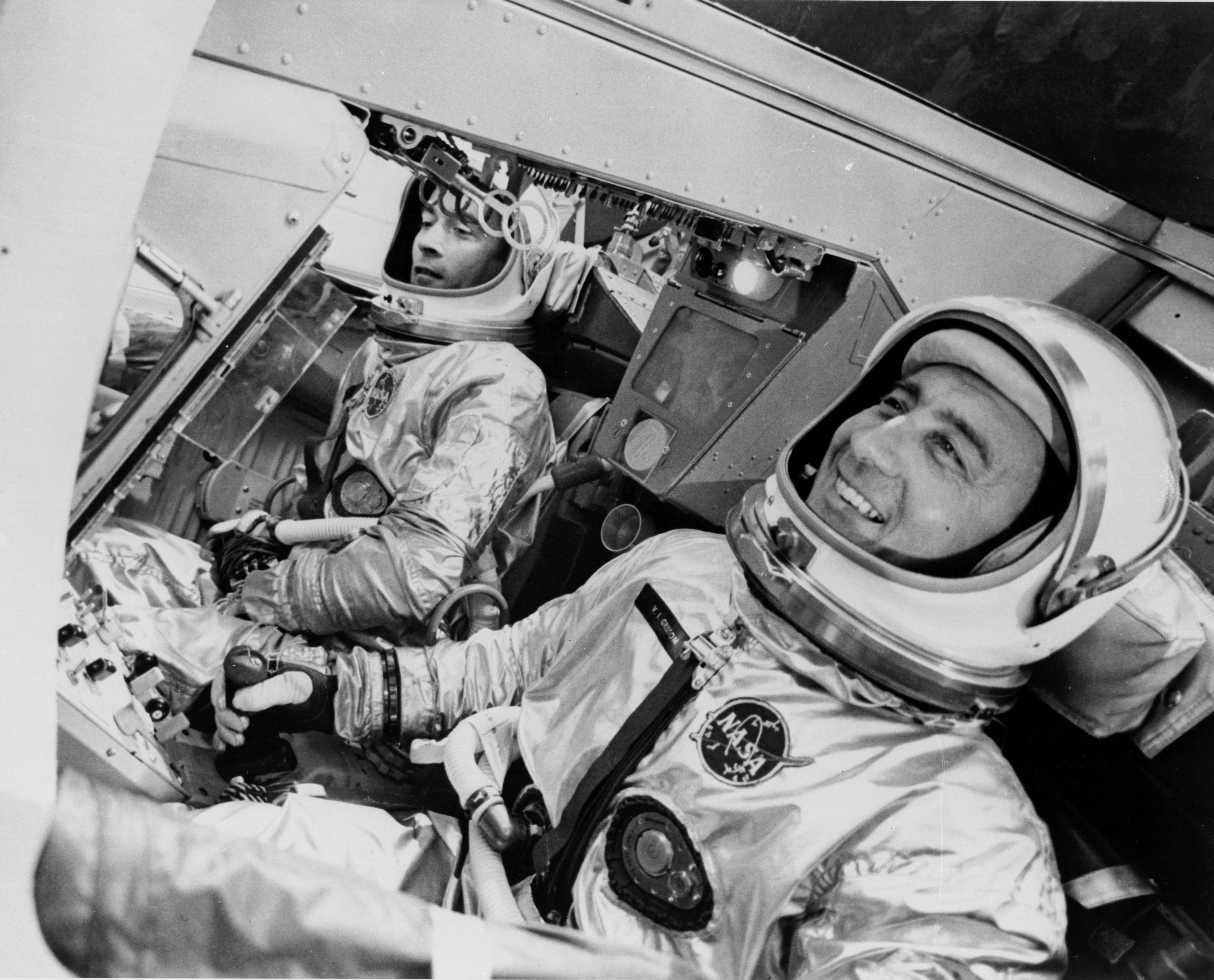 John Young pretending he didn't just stink up the whole cockpit on the left while Gus Grissom pretending he's never heard of corned beef.