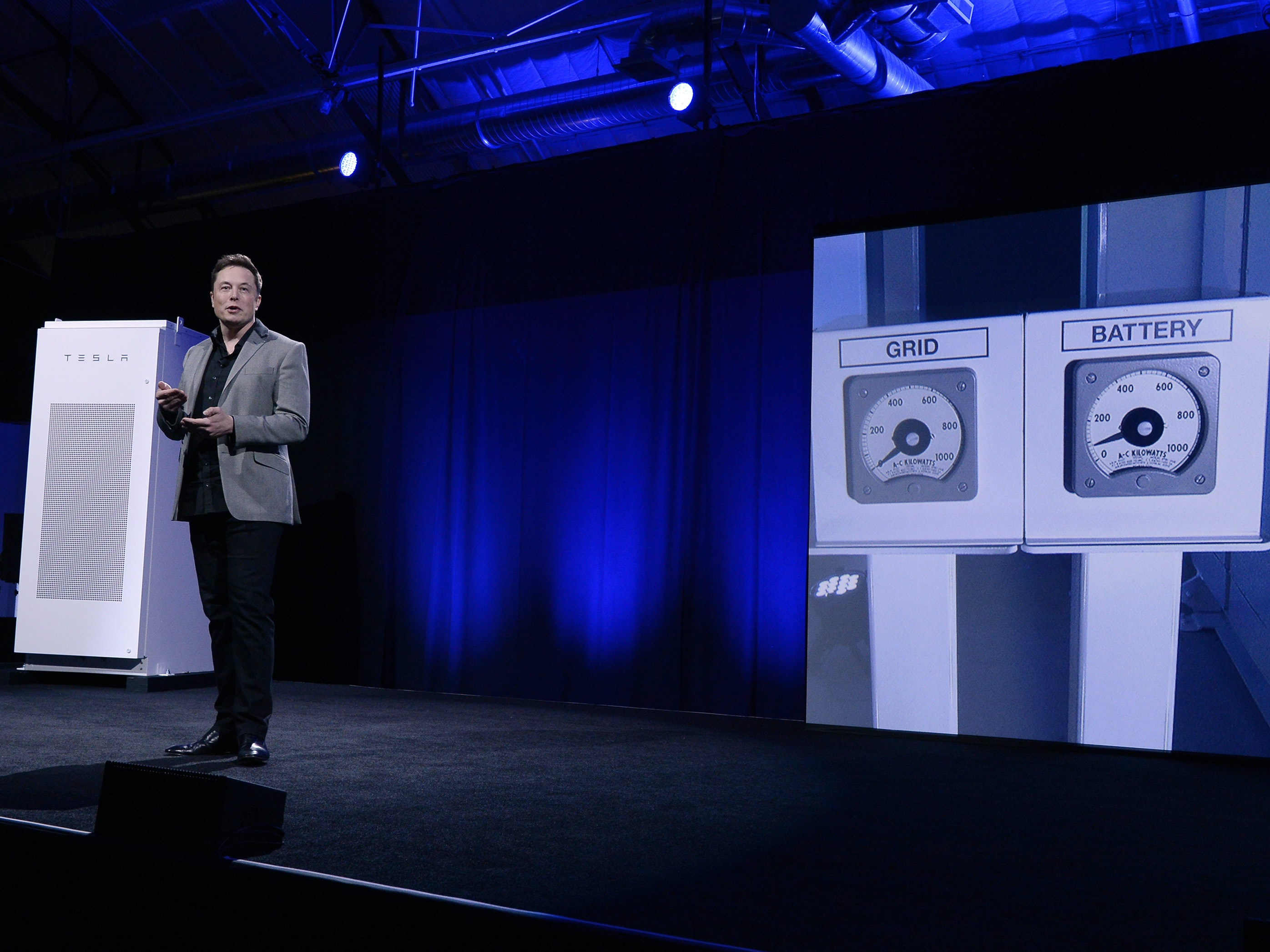 Elon Musk presenting his company's home-storage batteries.