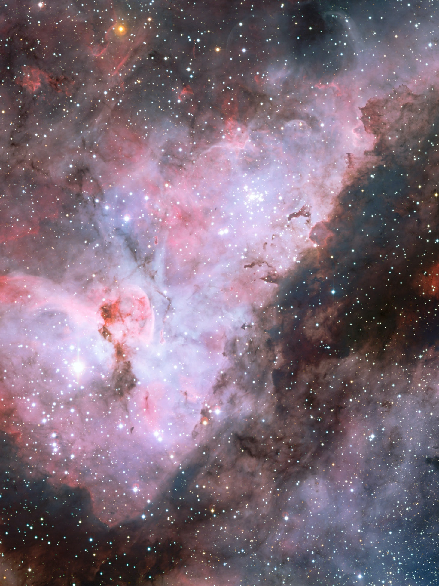 This spectacular panoramic view combines a new image of the field around the WolfRayet star WR 22 in the Carina Nebula (right) with an earlier picture of the region around the unique star Eta Carinae in the heart of the nebula (left). The picture was created from images taken with the Wide Field Imager on the MPG/ESO 2.2-metre telescope at ESO's La Silla Observatory in Chile.