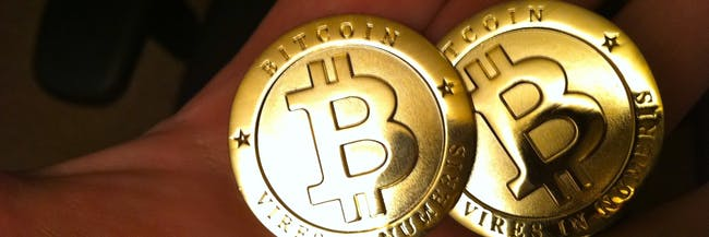 bitcoin tokens in hand cryptocurrency