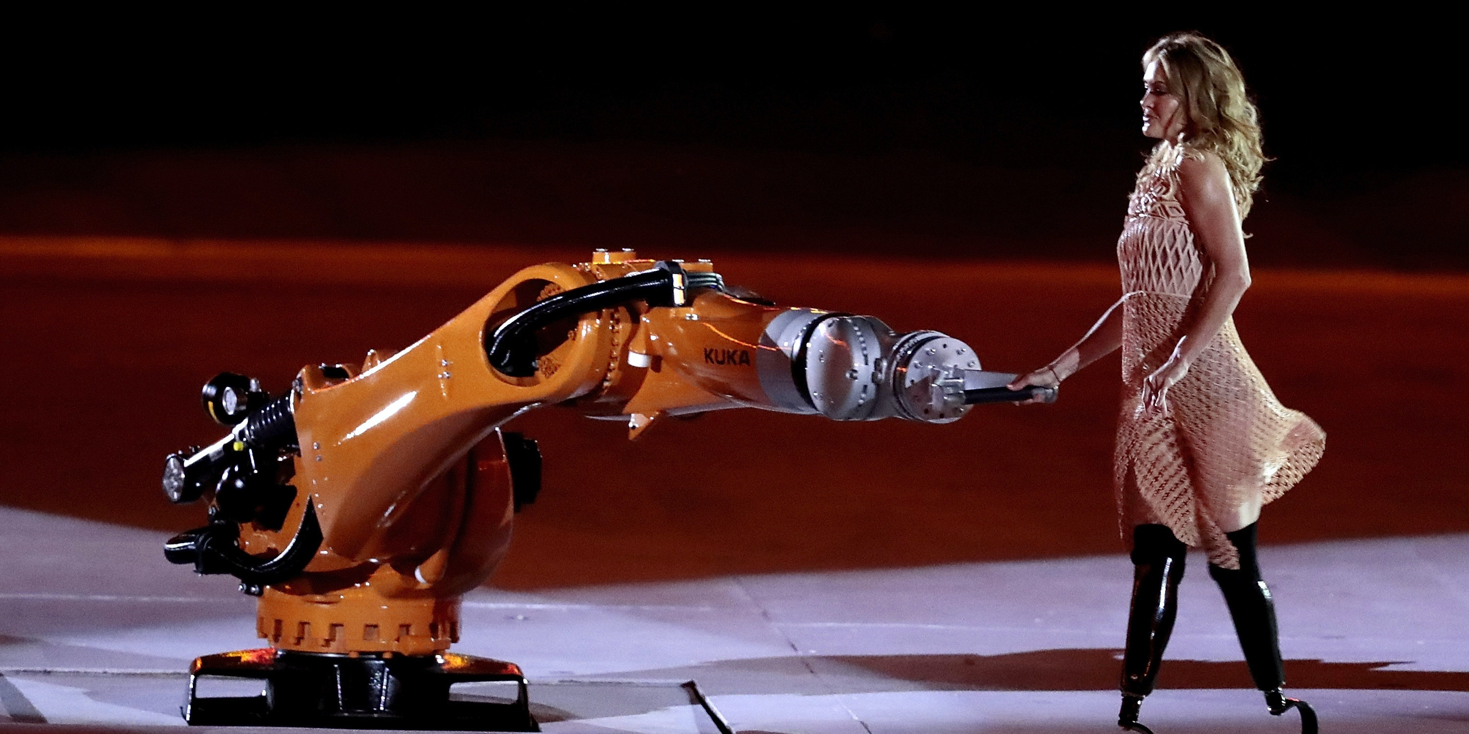 RIO DE JANEIRO, BRAZIL - SEPTEMBER 07: Amy Purdy dances with robot Kuka during the Opening Ceremony of the Rio 2016 Paralympic Games at Maracana Stadium on September 7, 2016 in Rio de Janeiro, Brazil.(Photo by Alexandre Loureiro/Getty Images)