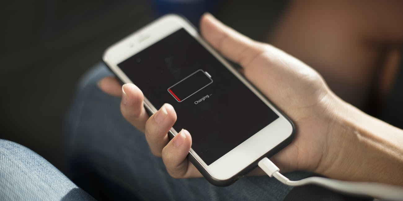 An iPhone smartphone charging its lithium-ion battery