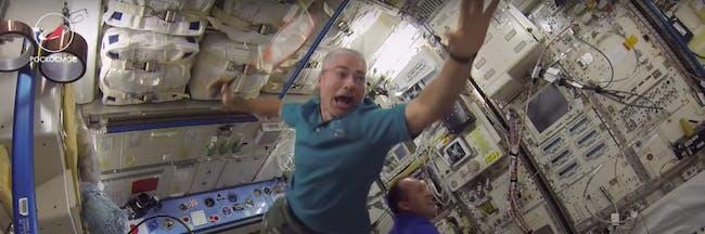 ISS crew members playing badminton.