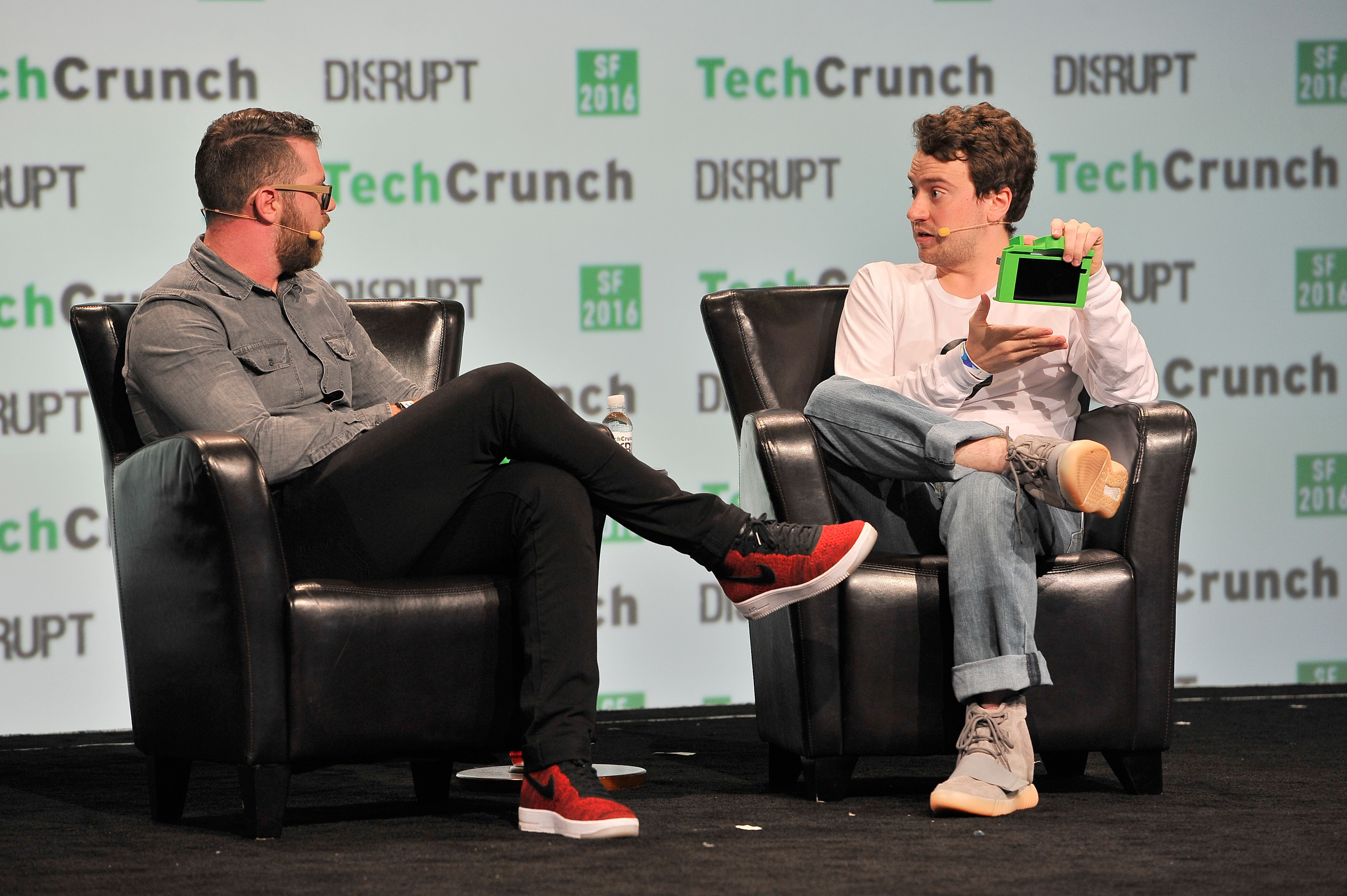 Moderator Darrell Etherington and CEO of Comma.ai George Hotz onstage during TechCrunch Disrupt SF 2016.