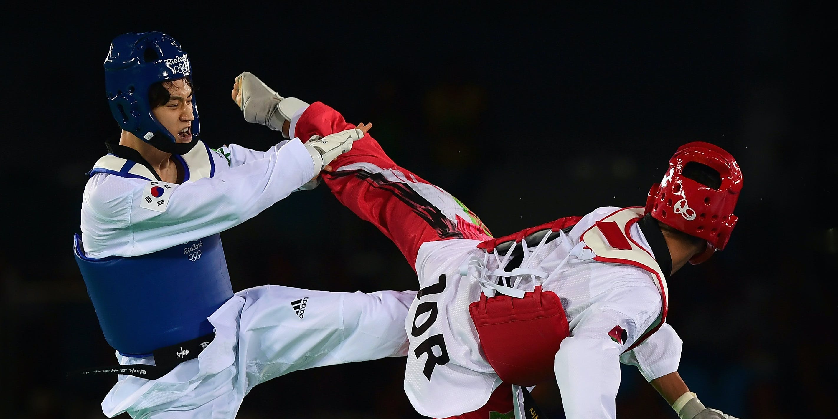 RIO DE JANEIRO, BRAZIL - AUGUST 18:  Ahmed Abughaush of Jordan (Red) competes against Daehoon Lee of Republic of Korea during the Mens 68kg Taekwondo quarter final contest at Cairoca Arena 3  on August 18, 2016 in Rio de Janeiro, Brazil.  (Photo by Laurence Griffiths/Getty Images)